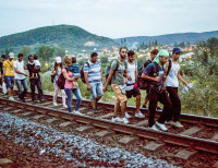 epa04913729 Migrants walk on the railway tracks near Tatabanya  57 kms west of Budapest, Hungary, 04 September 2015, after some 200-300 migrants broke out of the Bicske train station. At Bicske in Hungary, police and interpreters on 03 September urged refugees and migrants to leave a train bound for the western town of Sopron and board 20 waiting buses to a nearby camp, but many were promptly brought back to the station platform. Earlier, hundreds of migrants rushed the platforms in Budapest after Hungarian police opened the city's Keleti station, which had been blocked to migrants since 01 September. Hungary's railway service said there were no trains headed to Western Europe for the time being. Thousands of refugees - many of whom have traveled from Africa and the Middle East in the hopes of reaching countries like Germany and Sweden - have been stranded at the station.  EPA/BALAZS MOHAI HUNGARY OUT